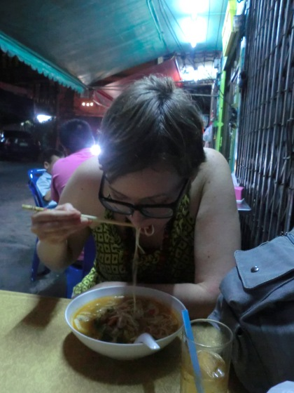 eating vegetarian tom yum noodle soup