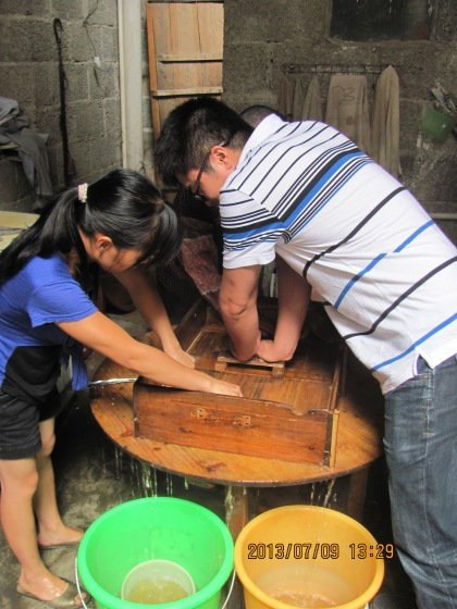 pressing the wooden lid